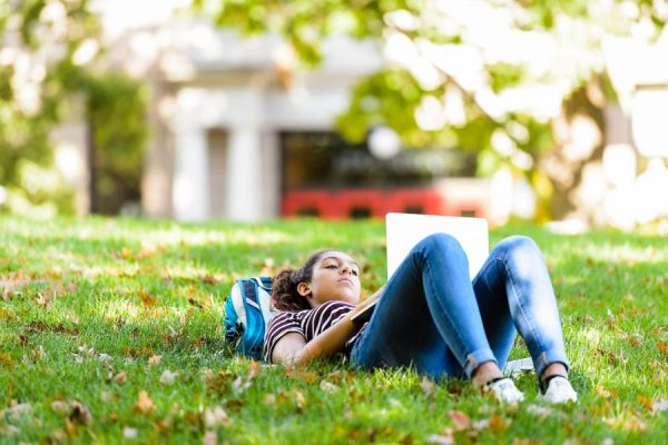 Student studying on Bascom Hill