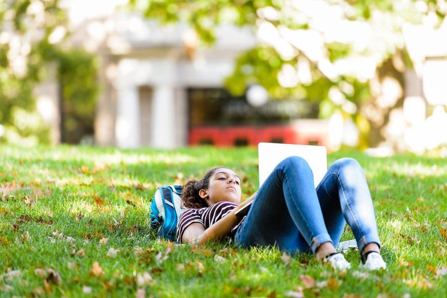 Student studying on Bascom Hill
